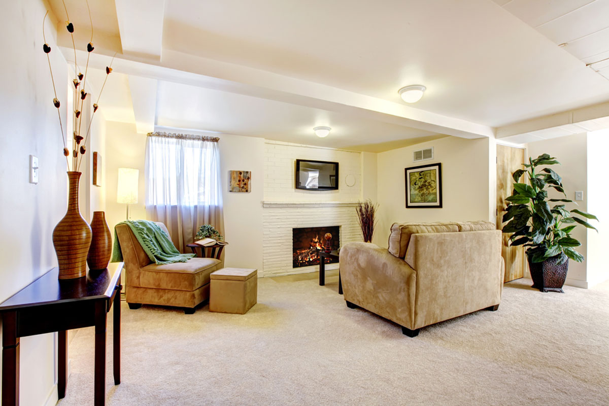 Plush White Carpet Installation In Living Room With Fire Place