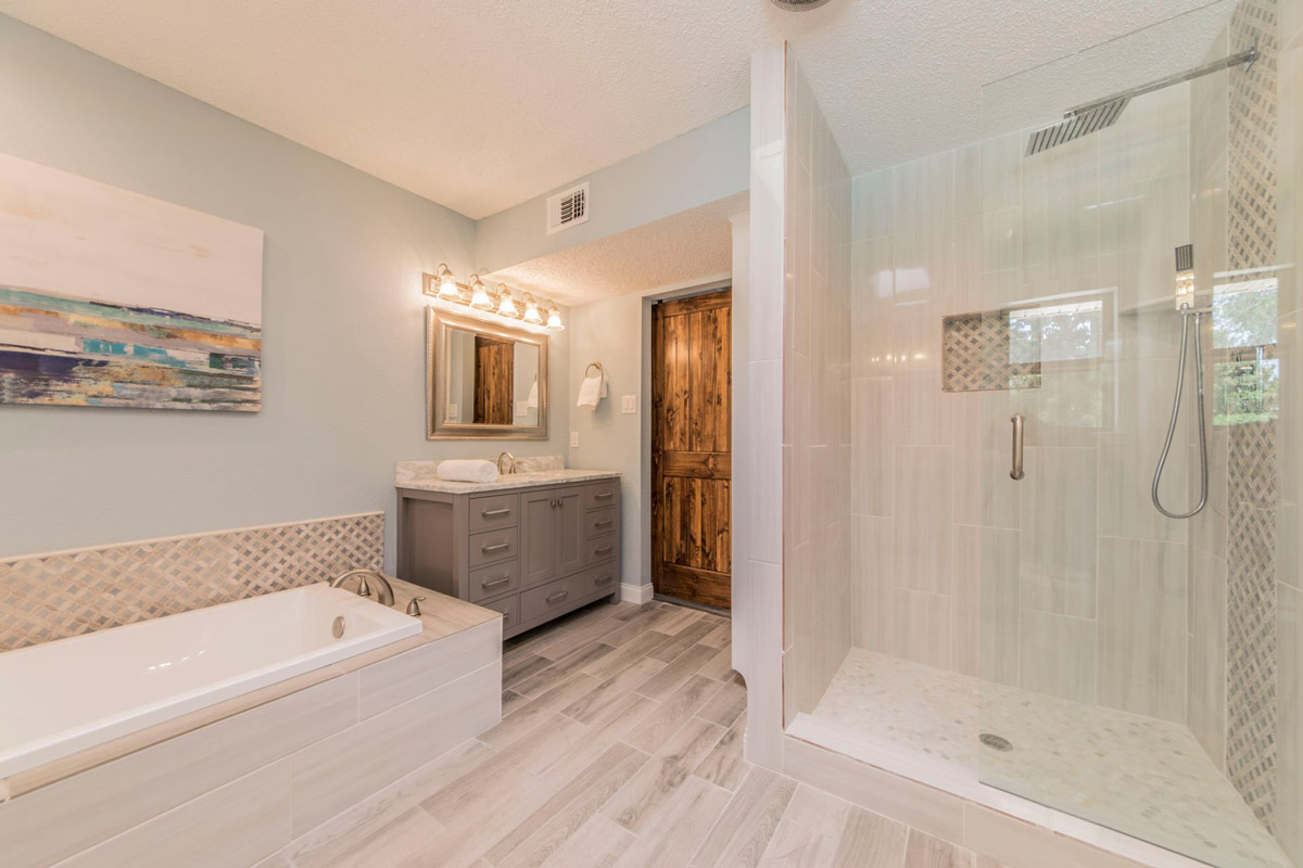 High-end master bathroom remodel with light-colored accents, and walk-in shower