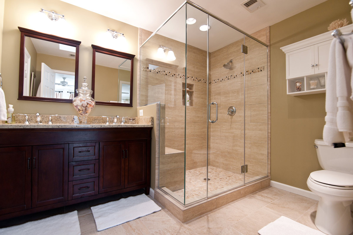 Master Bathroom Renovation With Glass Shower Door, Double Vanity, & Tile Throughout.
