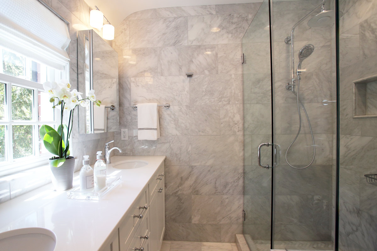 Modern and Luxury Bathroom Remodel with Floor to Ceiling Tile and Walk-in Shower.