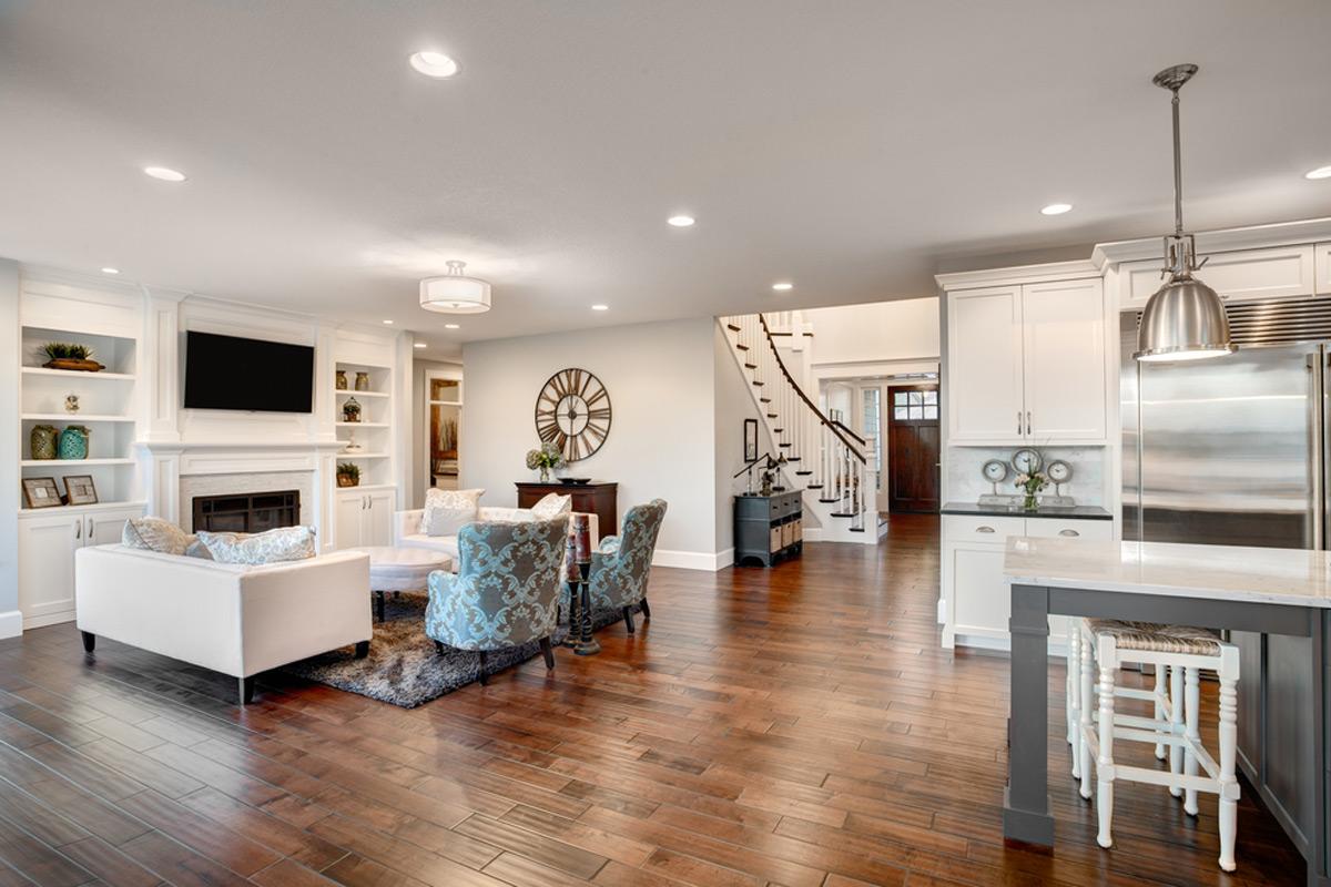 New Hardwood Floor Installation In Living Room And Kitchen