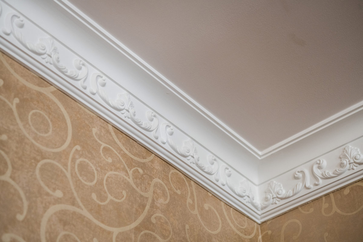 Plaster Crown Molding With Intricate Patterns On Trim