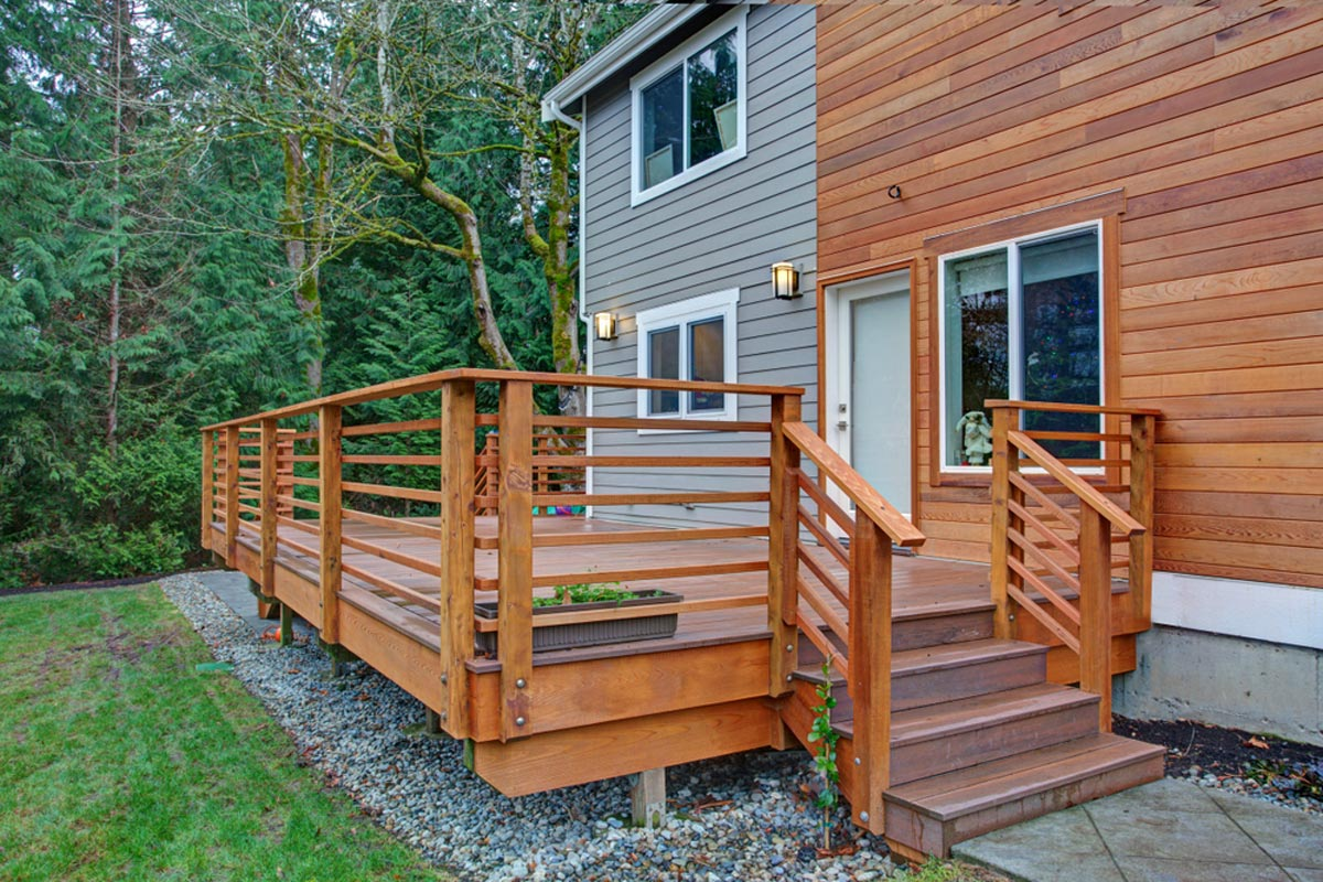 Raised Wooded Walkout Deck Construction With Railing Stairs And Steps