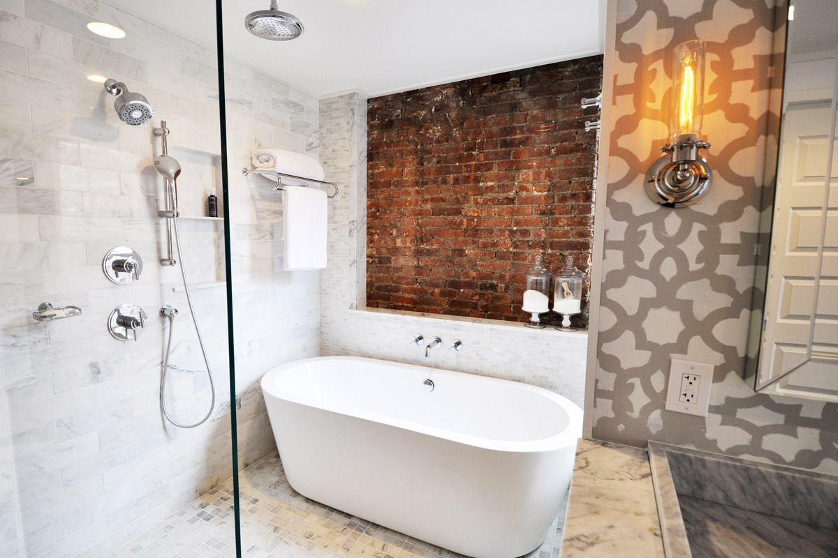Shower and Bathroom Remodel with Exposed Brick and freestanding tub