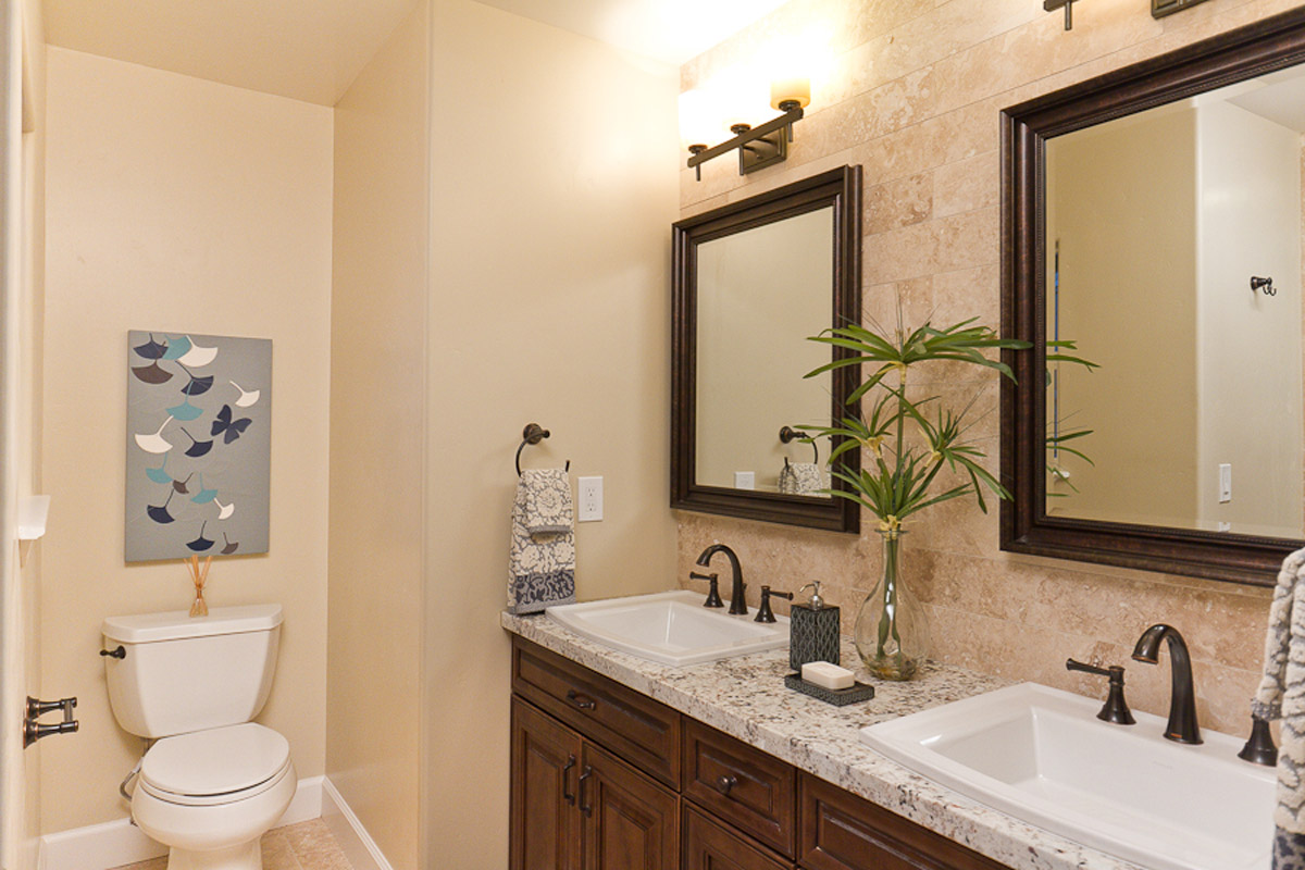 Small Bathroom Remodel - Upscale design with double sinks, wood cabinets