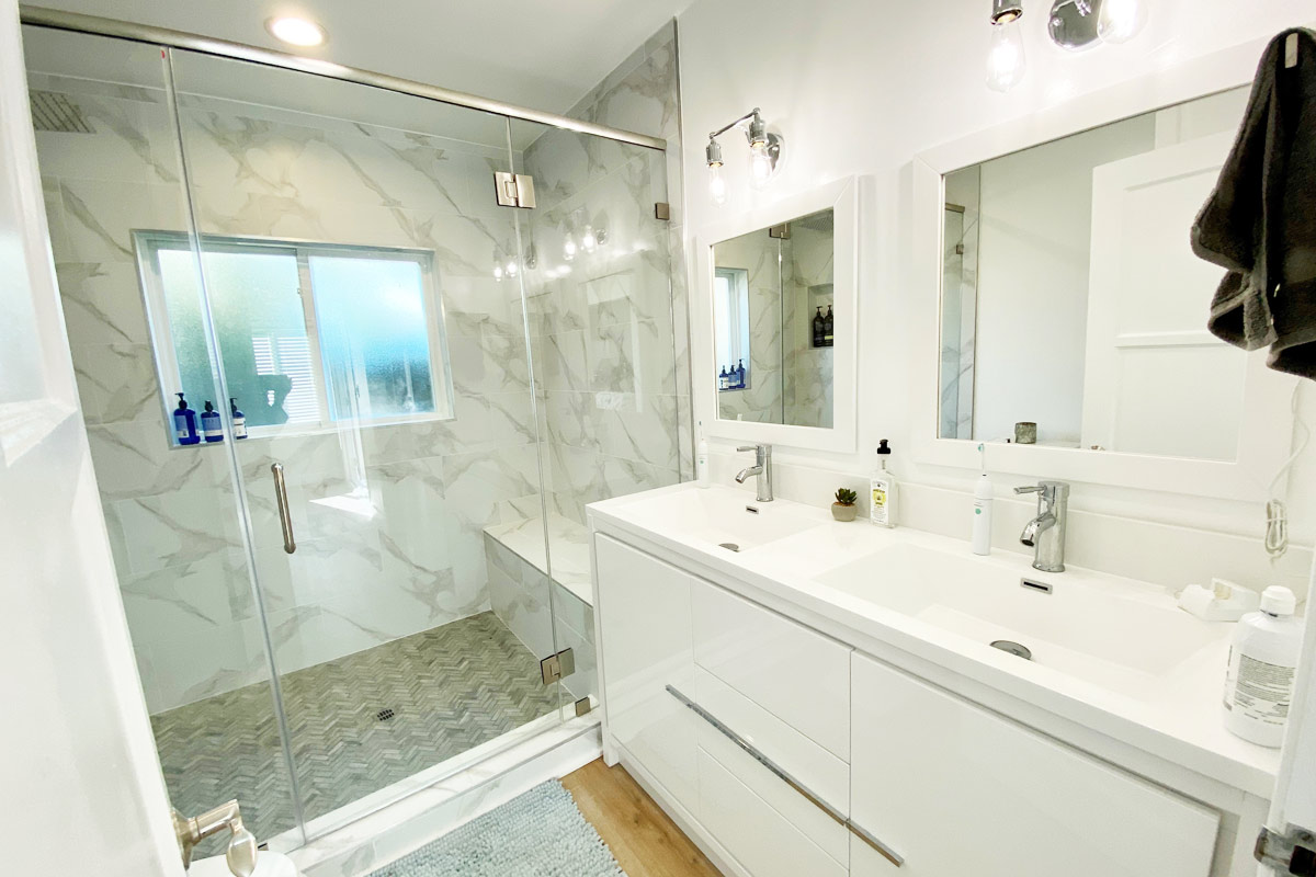 White and Gray Master Bathroom Remodel with Luxury Fixtures and Custom Tile Shower.